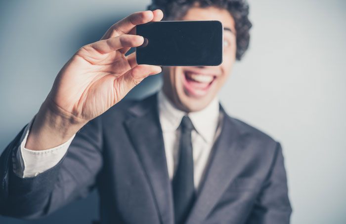 Can I Take a Selfie? 5 Rules for Modern Funeral Etiquette